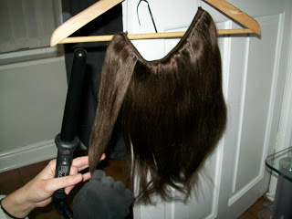 Halo Hair Extensions using straighteners on the extensions curling