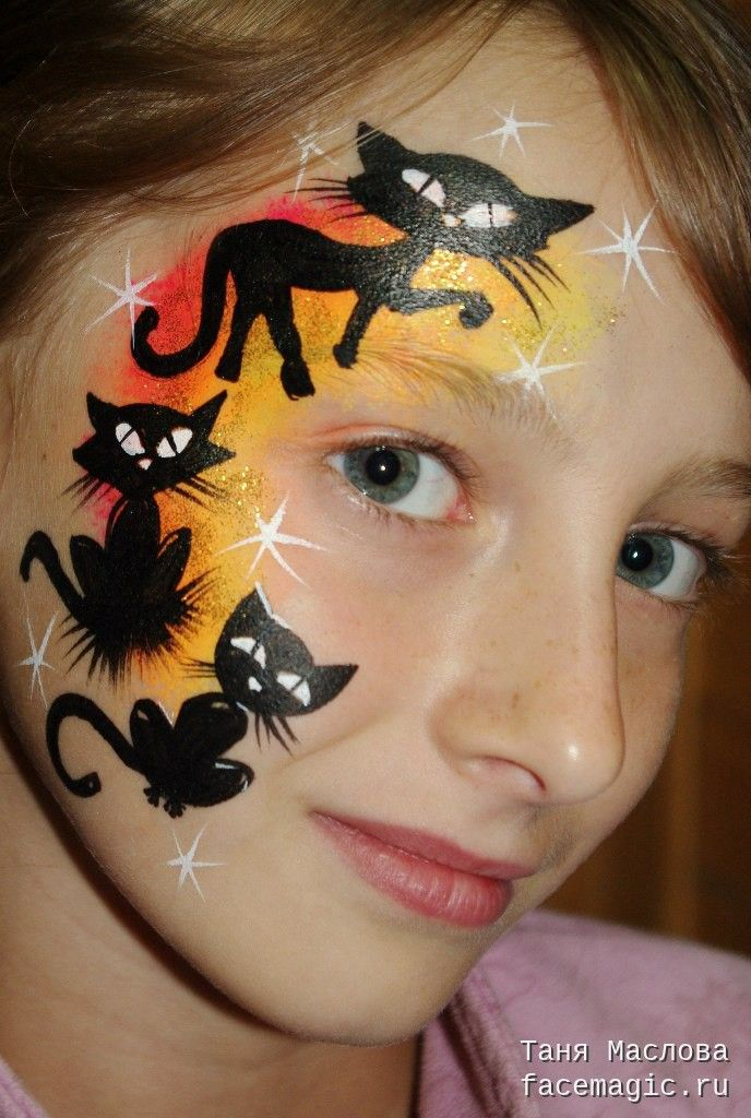 Witches black cat halloween face paint idea for kids