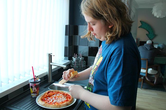 jake making pizza