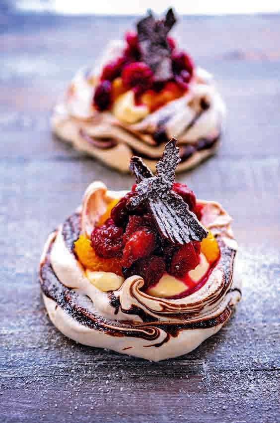 16 Awesome Christmas Day Dessert Recipes - mini cranberry orange and chocolate pavlova's recipe